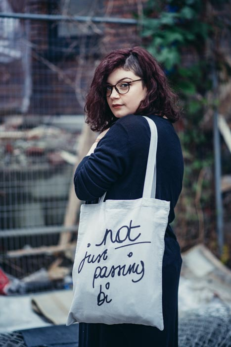 Not just passing bi tote bag